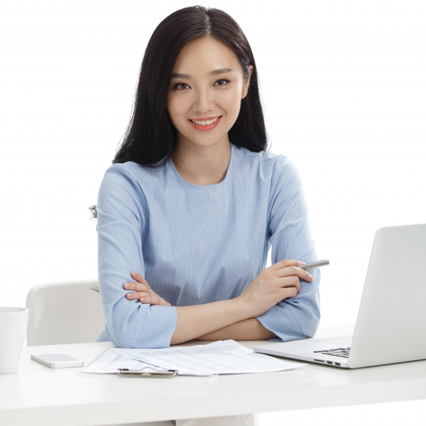 Woman teacher smiling with laptop